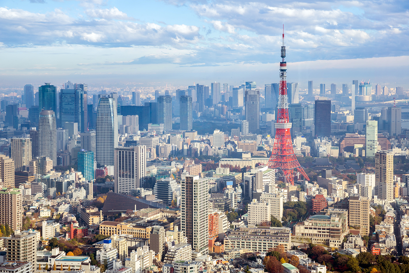 The fund makes its first real estate investments in Asia, acquiring 70 percent of five properties in Tokyo.